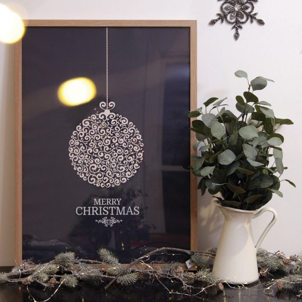 Merry Christmas Elegant Christmas Poster Placed in the living room beside a vase with green plant