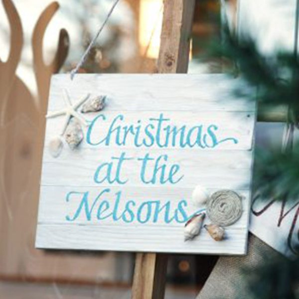 Personalised Beach Christmas Wood Plaque with seashells and Blue writing Christmas at the Nelsons