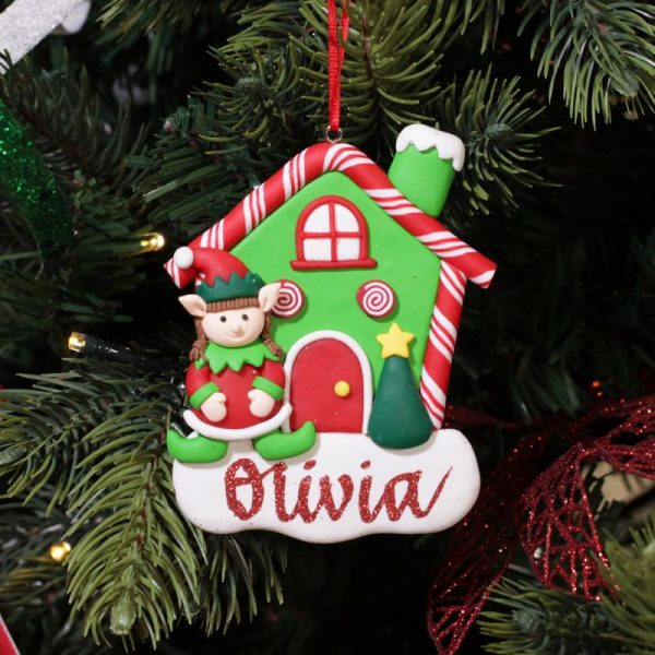A Christmas Kitchen Personalised Gingerbread House with Girl Elf Decor Hanging in a Christmas Tree Olive with red glitter writing
