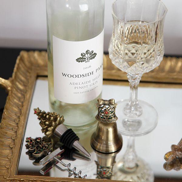 Brass Tree Corkscrew and Bottle Stopper Gift Set placed in a tray Empty bottle of Woodside Park Wine