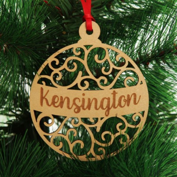 Personalised Bauble with Kensigngton writing Tree Decoration Hanging on a Christmas Tree