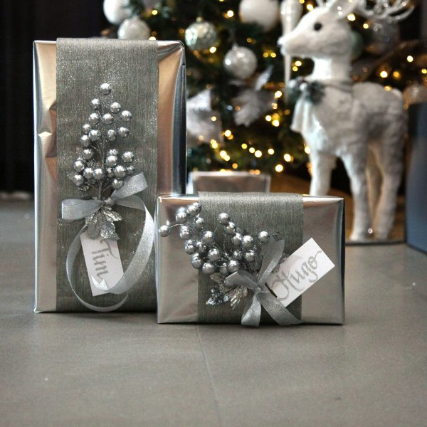 2 presents wrapped in silver ribbon & glitter berry, and infront of the White Sisal standing deer and a Christmas Tree