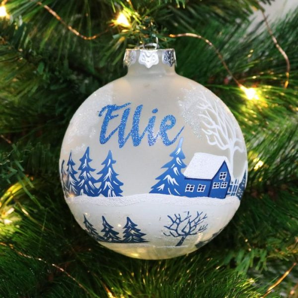 personalised frosted winter church christmas bauble hanging on tree name in blue glitter cottages tree snow painted
