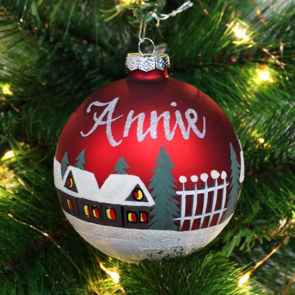 personalised red handpainted glass bauble hanging on tree name in silver glitter cottages tree and snow painted