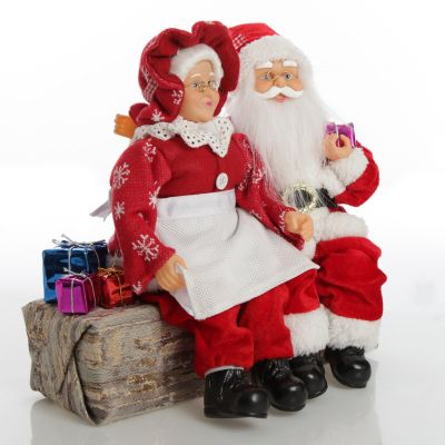 Mr & Mrs Claus with Presents Sitting on Log Christmas Ornament